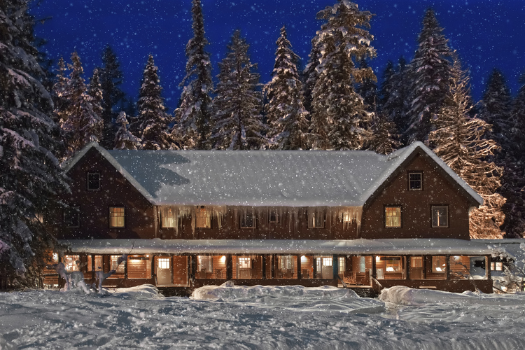 Twilight snowfall at mountain lodge